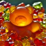 a mountain of big and small gummy bears